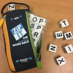 "Zip It, the ""small space word race"" game"